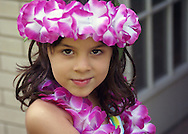 A young girl wearing leis.