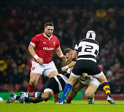 Dillon Lewis of Wales under pressure from Rory Best of Barbarians <br /> <br /> Photographer Simon King/Replay Images<br /> <br /> Friendly - Wales v Barbarians - Saturday 30th November 2019 - Principality Stadium - Cardiff<br /> <br /> World Copyright © Replay Images . All rights reserved. info@replayimages.co.uk - http://replayimages.co.uk
