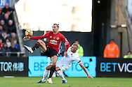Zlatan Ibrahimovic of Manchester Utd holds off Mike van der Hoorn of Swansea city. .Premier league match, Swansea city v Manchester Utd at the Liberty Stadium in Swansea, South Wales on Sunday 6th November 2016.<br /> pic by  Andrew Orchard, Andrew Orchard sports photography.