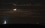 Greenville, NY -  The crescent moon, the High Point Monument and Jupiter, at right, on the evening of Dec. 1, 2008.