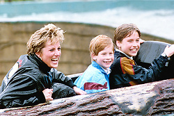Diana, Princess of Wales, with sons Prince William (r) and Prince Harry during a visit to 'Thorpe Park' amusement park