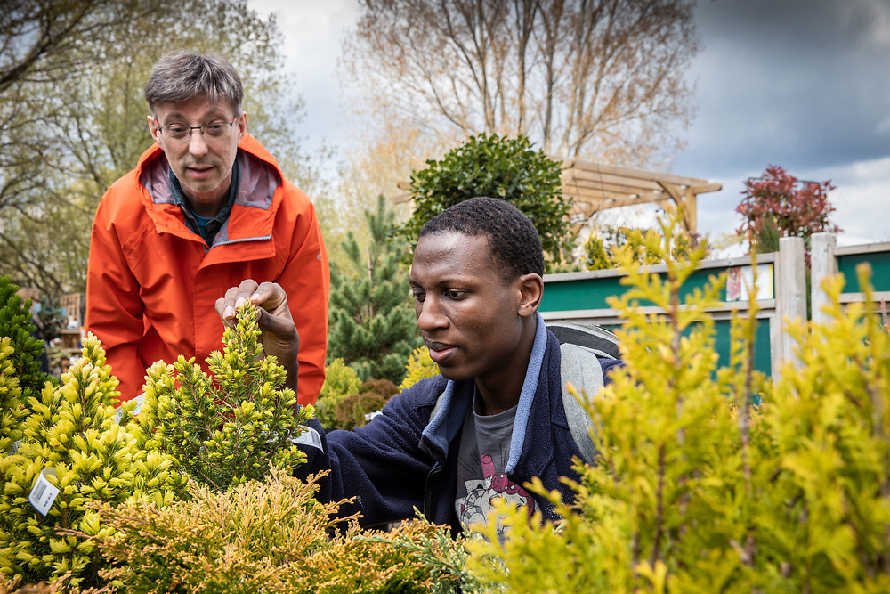 Support worker with service user visiting a garden centre. Client  - Allerton, an integrated social care, housing, and development company.
