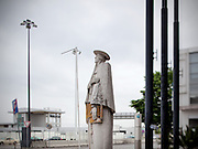Statue of Bartolomeu de Gosmão, inventor of the XVII century, next to the Lisbon Airpor.This photograph is part of a body of work about Lisbon, feelings, affections and loneliness. Is about a city depressed by the crisis, but even so, tolerant and cosmopolitan.