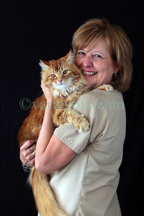 17 Oct 2012. New Orleans, Louisiana USA. .Lakeview Veterinary Hospital Inc. .Gayle Taylor and her cat. Reception..Photo Credit; Charlie Varley