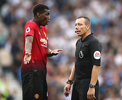 Manchester United's Paul Pogba (left) in discussion with Referee Kevin Friend