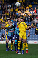 Cameron Brannagan of Oxford United heads the ball under pressure during the EFL Sky Bet League 1 match between Oxford United and Wycombe Wanderers at the Kassam Stadium, Oxford, England on 30 March 2019.