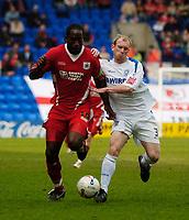 Photo: Jed Wee.<br />Tranmere Rovers v Bristol City. Coca Cola League 1. 22/04/2006.<br /><br />Bristol City's Mark McCammon (L) is challenged by Tranmere's Gareth Roberts.