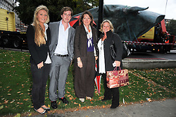 Left to right, GEORGIE BANKS, JAMIE KEITH, LOUISE WYNNE-GRIFFITH and CAROL KEITH at reception to see the installation of Horse at Water by Nic Fiddian-Green at Marble Arch, London on 14th September 2010.