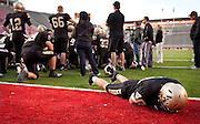 Lone Peak senior Josh Buck (40) lays on the ground following their loss in the Utah State High School 5A Football semifinal between Lone Peak and Jordan in Rice-Eccles Stadium, Thursday, Nov. 8, 2012.