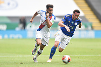 LEICESTER, ENGLAND - JULY 04: Andros Townsend of Crystal Palace finds a way past Christian Fuchs of Leicester City during the Premier League match between Leicester City and Crystal Palace at The King Power Stadium on July 4, 2020 in Leicester, United Kingdom. Football Stadiums around Europe remain empty due to the Coronavirus Pandemic as Government social distancing laws prohibit fans inside venues resulting in all fixtures being played behind closed doors. (Photo by MB Media)