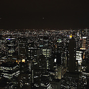 A panoramic night view of Manhattan, New York, from the Top of the Rock, the observatory deck at Rockefeller Center showing the Empire State Building, Manhattan, New York, USA. 26th November 2012. Photo Tim Clayton