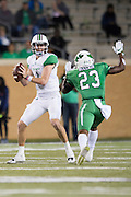Marshall Thundering Herd quarterback Chase Litton (1) is sacked by North Texas Mean Green defensive back Kishawn McClain (23) during the 2nd half at Apogee Stadium in Denton, Texas on October 8, 2016. (Cooper Neill for The Herald-Dispatch)