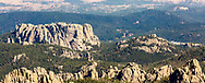 Photo taken September 30, 2017, shows backside of Mount Rushmore, as seen in the distance from Black Elk Peak. Visitor center parking lot is to the far right, center of photo, between pyramid rock formation and right margin.