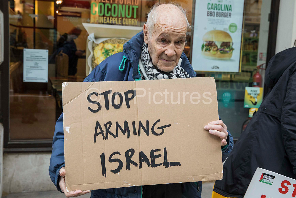 Pro-Palestinian activist Eric Levy, 92, holds a sign calling for an end to UK arms sales to Israel at a protest outside the UK headquarters of Elbit Systems, an Israel-based company developing technologies used for military applications including drones, precision guidance, surveillance and intruder-detection systems, on 11th May 2021 in London, United Kingdom. Activists from Palestine Action were protesting against the companys presence in the UK and in solidarity with the Palestinian people at a time of a significant rise in tension in Israel and the Occupied Territories following attempts at forced evictions of Palestinian families in the Sheikh Jarrah neighbourhood of East Jerusalem, the deployment of Israeli forces at the Al-Aqsa mosque and the killing of children in Gaza.