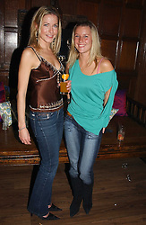 Left to right, MISS SOPHIE JOHNSTONE and MISS LUCY AUSTIN at a party to celebrate the 4th anniversary of Quintessentially held at 11 Grosvenor Place, London  SW1 on 14th December 2004.<br />