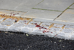 © Licensed to London News Pictures. 31/03/2019. London, UK. Blood stains at the crime scene on Fore Street in Edmonton, north London where a person was stabbed just after 9.30am this morning. According to the The victim was transferred to a hospital by Air Ambulance and his condition is unknown. Photo credit: Dinendra Haria