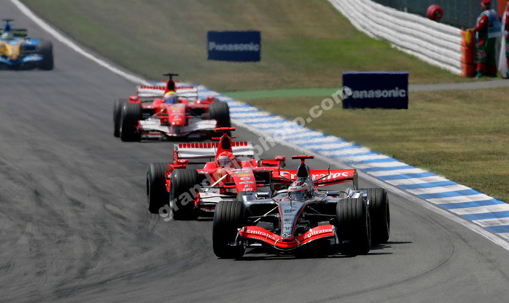Kimi Raikkonen (McLaren-Mercedes) leads Ferrari drivers Michael Schumacher and Felipe Massa into the hairpin on the first lap of the 2006 German Grand Prix at Hockenheim. Photo: Grand Prix Photo