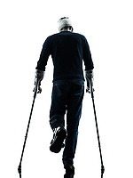 one man injured man walking rear view with crutches in silhouette studio on white background