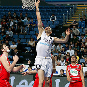 Efes Pilsen's Igor RAKOCEVIC (C) and Pinar Karsiyaka's Sean MARSHALL (R) during their Turkish Basketball Legague Play-Off qualifying first match Efes Pilsen between Pinar Karsiyaka at the Sinan Erdem Arena in Istanbul Turkey on Wednesday 11 May 2011. Photo by TURKPIX