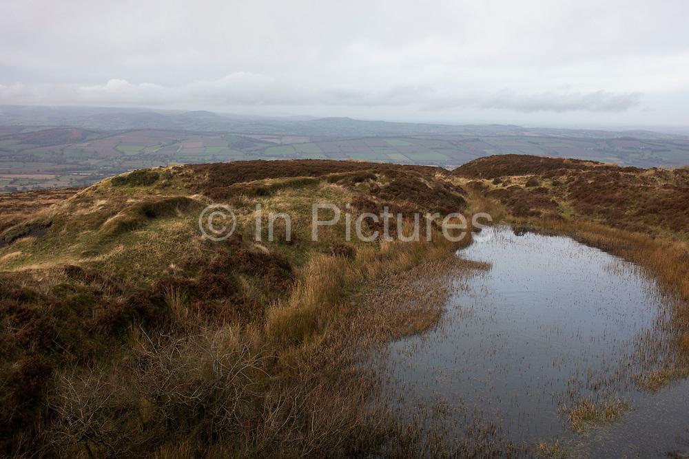 Landscape view looking from the top of Brown Clee Hill out over the Shropshire Hills, a designated Area of Outstanding Natural Beauty on 13th November 2019 near Burwarton, Shropshire, United Kingdom. The Shropshire Hills, located in the Welsh Marches, are relatively high: the highest point in the county, Brown Clee Hill, near Ludlow, has an altitude of 540 metres.