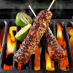 Kebabs being cooked over hot charcoal. Food photos, pictures & images.