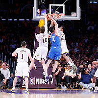 09 March 2014: Oklahoma City Thunder power forward Nick Collison (4) is blocked by Los Angeles Lakers center Pau Gasol (16) and Los Angeles Lakers shooting guard Kent Bazemore (6) during the Los Angeles Lakers 114-110 victory over the Oklahoma City Thunder at the Staples Center, Los Angeles, California, USA.