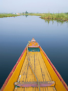 A shikara, a local wooden boat, on Lake Dal, Kashmir, India