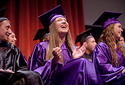 Summit High School graduate Mikaela Kessler laughs as Principal Beth Auge delivers a string of inside jokes during a graduation ceremony speech Thursday at Center for the Arts.