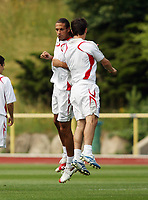 Photo: Chris Ratcliffe.<br />England Training Session. FIFA World Cup 2006. 29/06/2006.<br />Rio Ferdinand and Gary Neville in training.