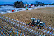 Mike Wunrow harvests a field of corn near Potter wisconsin Farmers are usually done with field work like this before the snow hits, but with this years wet conditions many have had to wait for the ground to freeze to get out in to the fields. The farm will use the corn to feed their steers.