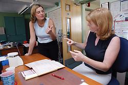 Women using sign language,