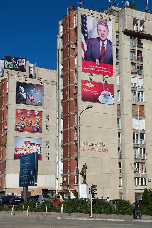 Poster and statue of Bill Clinton in Pristina, Kosovo.
