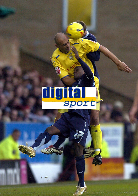 Photo: Olly Greenwood.<br />Southend United v Preston North End. Coca Cola Championship. 11/11/2006. Preston's Danny Dichio wins a header from Southend's Jamal Campbell-Ryce and SImon Francis
