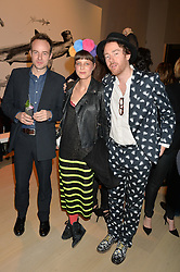 Left to right, actor PATRICK KENNEDY and PHILIP & CHARLOTTE COLBERT at Fashions for The Future presented by Oceana's Junior Council held at Phillips Auction House, 30 Berkeley Square, London on 19th March 2015.
