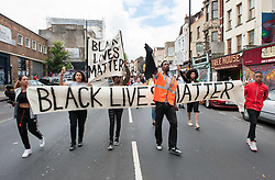 © Licensed to London News Pictures.10/07/2016. Bristol, UK.  Black Lives Matter march through Bristol from St Pauls to College Green, following the killings of black men in the USA. Photo credit : Simon Chapman/LNP