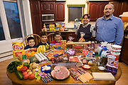 Nunavut, Canada. Family portrait of the Melanson family with one week's worth of food in October. The Hungry Planet project.