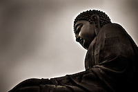 A profile of Tian Tan Buddha on Lantau Island, Hong Kong. This is one of the world's tallest outdoor bronze buddhas and is reached after climbing 268 steps.