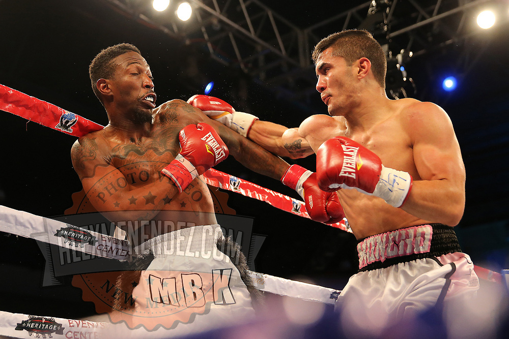 Henry Lebron lands a right hand shot to the upper body of Ronnie Jordan during a Telemundo boxing match between at Osceola Heritage Park on Friday, February 23, 2018 in Kissimmee, Florida.  (Alex Menendez via AP)