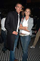 MR JACOBI ANSTRUTHER-GOUGH-CALTHORPE and MISS CLEMMIE HAMBRO at a party hosted by Frankie Dettori, Marco Pierre White and Edward Taylor to celebrate the launch of Frankie's Italian Bar & Grill at 3 Yeoman's Row, London SW3 on 2nd September 2004.