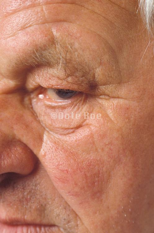 close up of a face of an older man