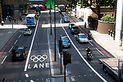 London, UK. Wednesday 25th July 2012. Busy traffic on a games lane at Upper Thames Street on the Olympic Route Network. Transport is a huge issue in and around the London 2012 Olympic Games. With many roads closed off to regular traffic, the inevitable problems occur.