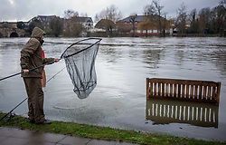 © Licensed to London News Pictures. 04/02/2021. London, UK. An angler takes advantage of the rising Thames in Chertsey, Surrey. Flooding in parts of Laleham and Chertsey in Surrey as rising flood water continues to rise around riverside properties in the area. The Uk is set to be battered by heavy rainfall, flooding and snow storms this weekend as the Met Office issue warnings that snow could hit most of the country in the coming days. Photo credit: Alex Lentati/LNP