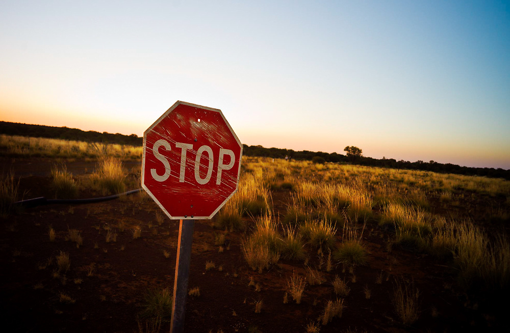 A Stop sign on. a mine road in the West Australian goldfields desert.