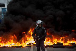 April 28, 2017 - Sao Paulo, Brazil - Protesters block an avenue with burning tires, during the general strike in Brazil, this Friday. The strike is against the proposed labor and pension changes. (Credit Image: © Paulo Lopes via ZUMA Wire)
