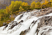 Waterfalls at the outlet of Stuvdalsvatnet Lake above Sorvagen, Moskenesoya, Lofoten Islands, Norway.