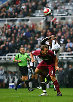 Photo: Andrew Unwin.<br /> Newcastle United v Bolton Wanderers. The Barclays Premiership. 15/10/2006.<br /> Newcastle's Titus Bramble (R) clashes painfully with Bolton's Kevin Davies (L).