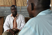 In Longech village, Northern Kenya, the UK based charity Merlin run a mobile Voluntary Counselling & Testing (VCT) unit for HIV and AIDS. VCT counsellor John Baraza talks to a local man & wife about living with the virus and illness.