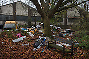 Fly tipping of refuse and van on the edge of a park during the second national coronavirus lockdown on 28th November 2020 in London, United Kingdom. The coronavirus lockdown saw a surge in fly tipping due to an increase of household waste and the closure and controlled visiting rules for tips and recycling centres. The new national lockdown is a huge blow to the economy and for individuals who were already struggling, as Covid-19 restrictions are put in place until 2nd December across England, with all non-essential businesses closed.