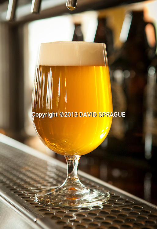A glass of the Trois Filles Tripel at LadyFace Ale Companie in Agoura Hills, CA. Shot Feb. 5th,  2013 Photo by David Sprague ©2013
