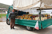 Greece, Macedonia, Prespa lakes, Psarades village selling preserved fruit and vegetables from the back of a truck